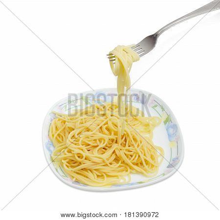 Fragment of the stainless steel fork with some cooked long thin cylindrical pasta over of a dish with the same pasta on a light background