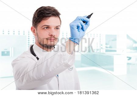 Portrait Of Medic Or Doctor Writing On Screen