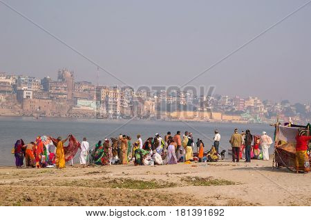 Women - Indian Women Wash And Bathe On The Opposite Bank Of The Ganges From Varanasi.