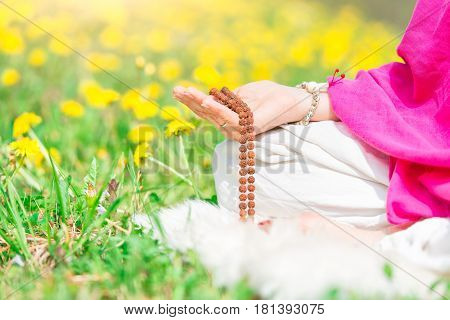 Yoga Practice In Nature Holding The Mala