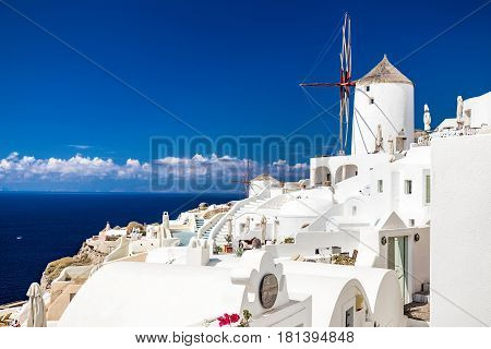 Romantic wind mill in Oia village at sunset. Beautiful views on mediterranean sea. Santorini,Thira island .Cyclades. Greece. Europe.
