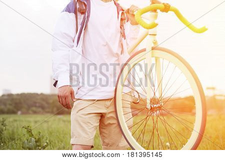 Young Man In Blank T-shirt Standing With Bicycle On His Shoulder (intentional Sun Glare And Bright C