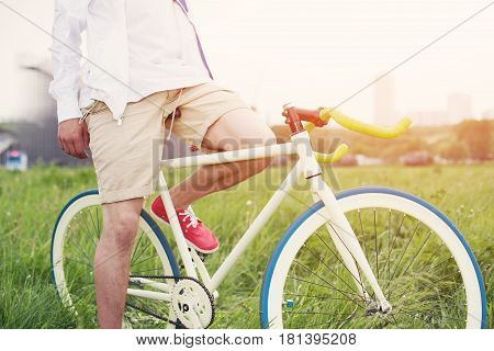 Man Sitting On His Bicycle In The Field (intentional Sun Glare And Bright Colors)
