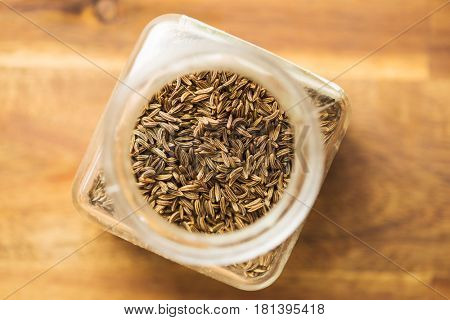 Cumin seeds or caraway in jar.
