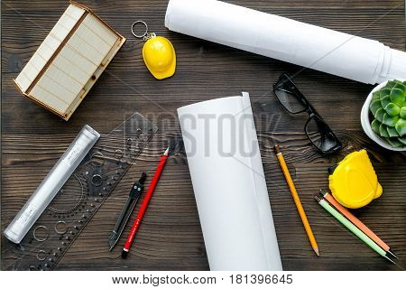Construction office with architect working tools on wooden table background top view