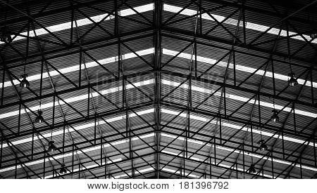 Black and white image of Steel structure roof frame for building construction.