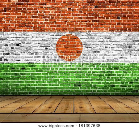Niger flag painted on brick wall with wooden floor