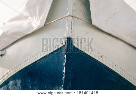 Cropped Image Of A Metal Boat Covered With Tarpaulin