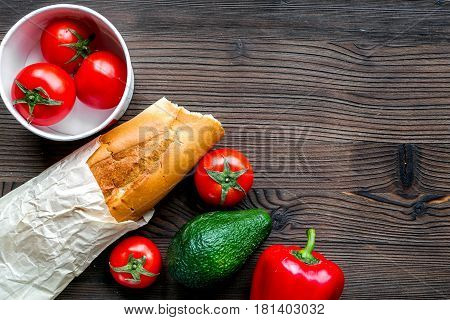 Store concept with vegetables and baguette on wooden table background top view mockup