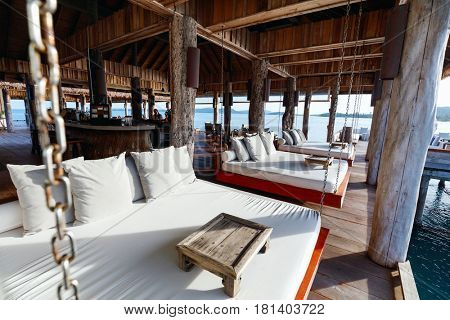 Interior of tropical overwater bar in a luxury resort