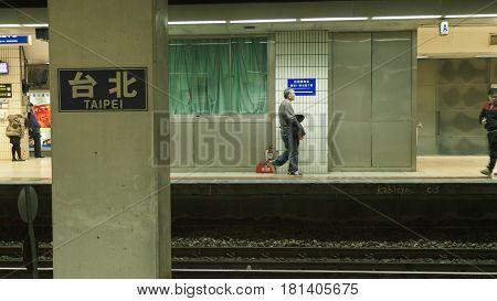 Taipei Taiwan26 Dec2014 - the paltform of Taipei station people passing by