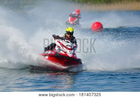 WYBOSTON, BEDFORDSHIRE, ENGLAND -  APRIL 09, 2017: Jet Ski competitors cornering at speed creating at lot of spray.