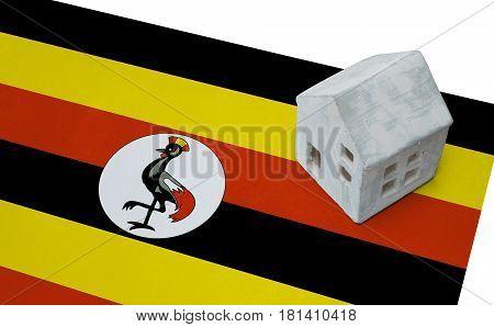 Small House On A Flag - Uganda