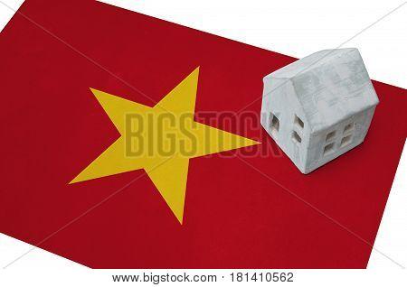 Small House On A Flag - Vietnam