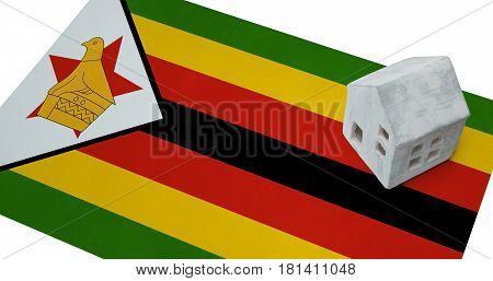Small House On A Flag - Zimbabwe