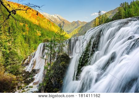 Scenic View Of The Pearl Shoals Waterfall Among Wooded Mountains