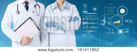 healthcare, people, cardiology and medicine concept - smiling doctors with stethoscope and cardiogram on clipboard over blue background and virtual charts