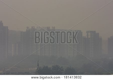18 Sep2014 Beijing China building shot in beijing on a foggy day above the building is the name of that building - tai yang xing cheng