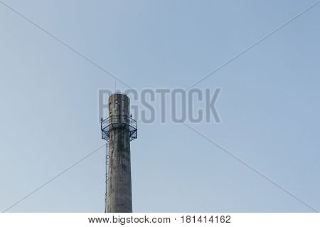 a Chimnery without smoke in blue sky