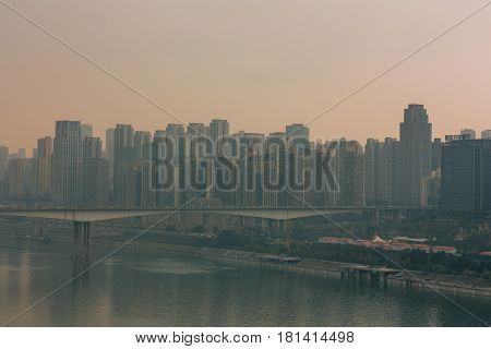 Chongqing China - Dec 22 2015: The view of foggy crowded city bridges beside the jialing river