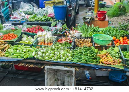 unclean vegetable sale food stall in upcountry rural street market in Asia.