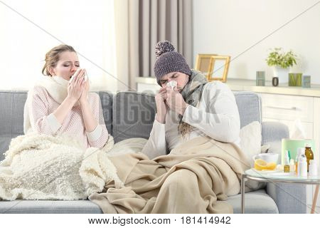 Ill couple on couch at home