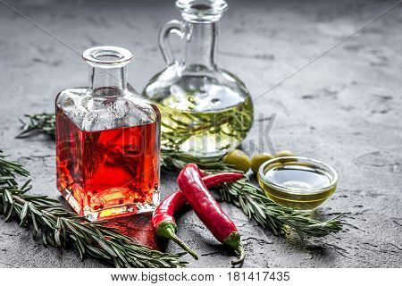 organic olive and chili oil with fresh ingredients on stone kitchen table background