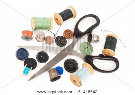 Spool of thread with buttons and scissors