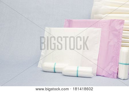 Heap of menstruation sanitary soft pads and cotton tampons for woman hygiene protection. Woman critical days gynecological menstruation cycle. Medical conception