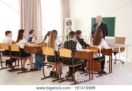 Pupils listening to teacher in classroom