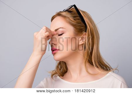 Attractive Business Woman Tired At Work Suffering From Headache