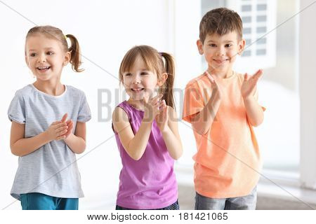Cute kids singing in music class