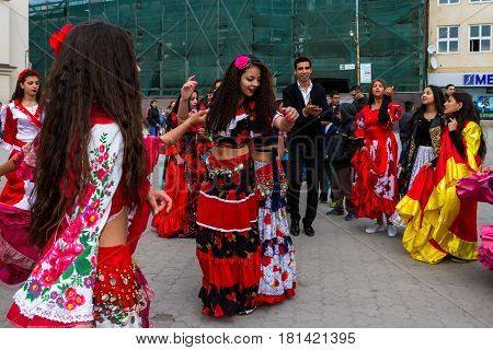 Uzhhorod Ukraine - April 7 2017: Participants in the celebration of the International Roma Day perform Romany folk dances in the city center.