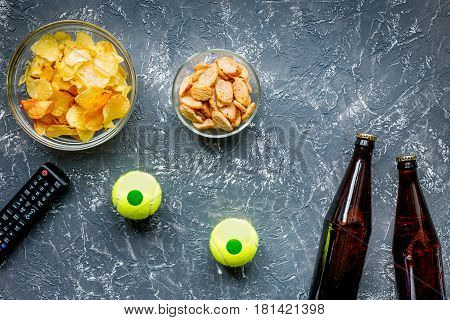 watching movies concept with chips and beer on dark table background top view mock up