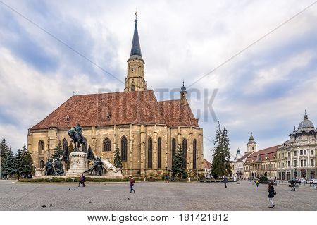 CLUJ-NAPOCA ,ROMANIA - MARCH 20,2017 - Church of St.Michael with statue of Matei Corvin in Cluj - Napoca. Cluj-Napoca is located in the central part of Transylvania.