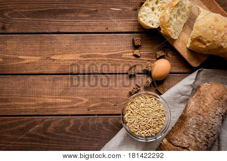 bakery concept with homemade fresh wheat and rye bread on rustic kitchen table background top view moke-up