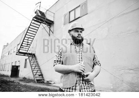 Brutal Beard Worker Man Suit Construction Worker In Safety Orange Helmet Stay Near Big Industrial St