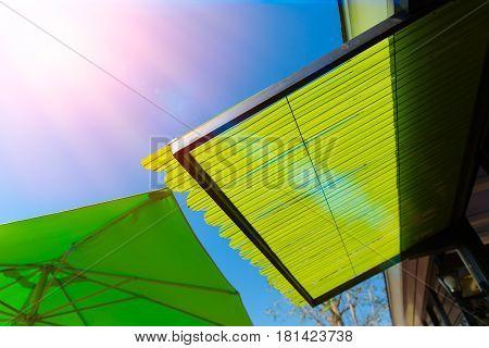 summer season cafe plastic sunshade roof protect sun light high danger uv.