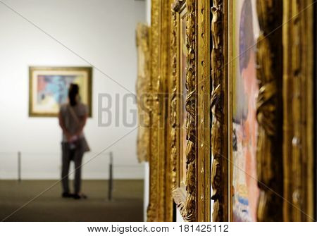 TEL AVIV ISRAEL - APRIL 12 2016: Girl looks at a painting at the Museum of Art