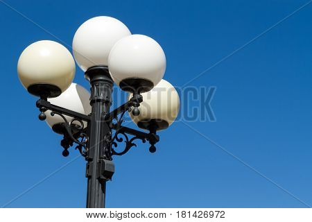 A street lamp waiting to light the night