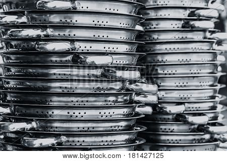 Stainless steel of kitchen ware stack for sale in the market.