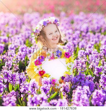 Little Girl In Hyacinth Field