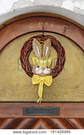 WEISSENKIRCHEN-IN-DER-WACHAU/ AUSTRIA - APRIL 1, 2017. Easter Bunny on the front door of a residential house. Town Weissenkirchen-in-der-Wachau, Lower Austria.