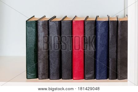 Black and red books on the shelf