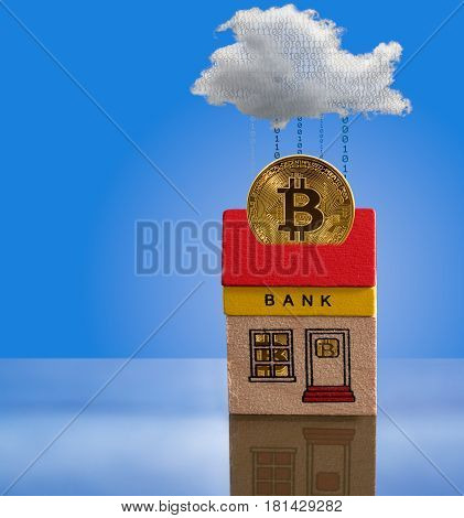 Toy brick bank building with bitcoins inside the windows and one coin emerging from roof into cyberspace. Illustration of the importance of modern techology to banking