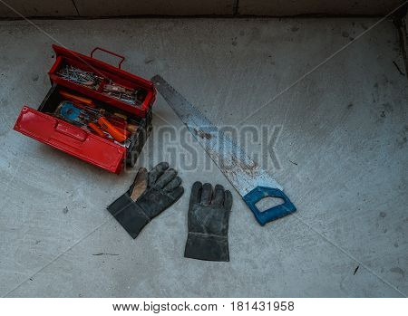 BangkokThailand - March 26 2017 : Red metal tool box with many tools on concrete floor