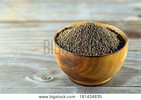Perilla frutescens or sesame in wood bowl on wooden floor.