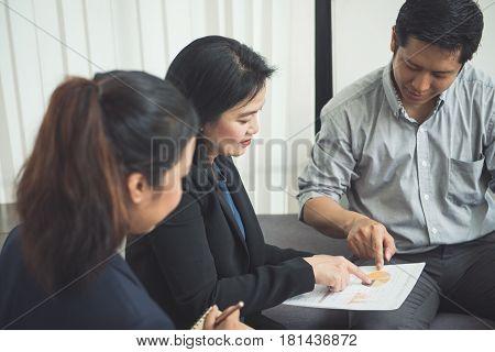 Pretty business interns listening to their team leader. Vintage filtered image.