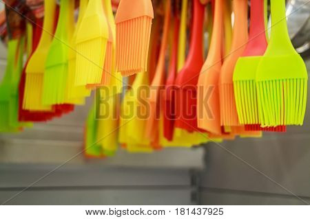 Close up colorful silicon brushes hanging in grocery store