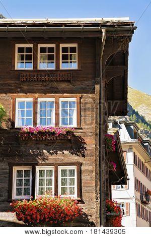 Chalet With Flowers On Balconies In Zermatt Resort Town Switzerland